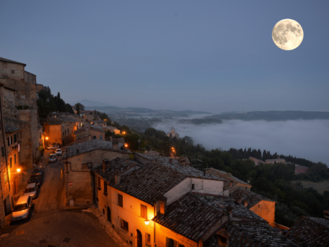 Vuew if Tuscany town in moonlight